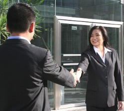People Shaking Hands - Escrow Process